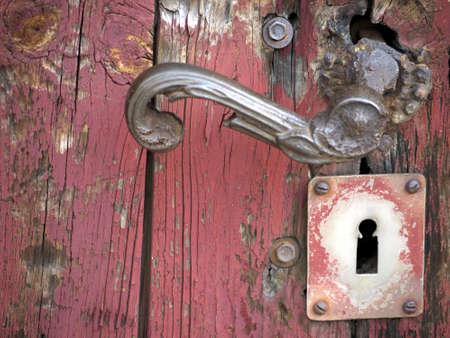 doorhandle: Doorhandle on a formerly red door