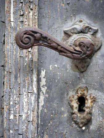 doorhandle: rusty doorhandle with a duck head on an old wooden door