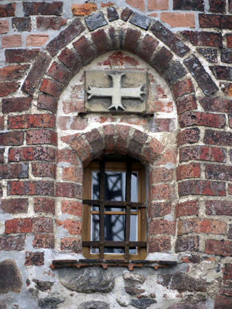 burg: Window and cross in the witches tower in Burg, near Magdeburg Stock Photo