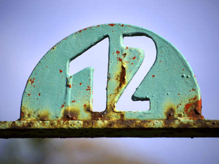 number 12: House number plate with number 12