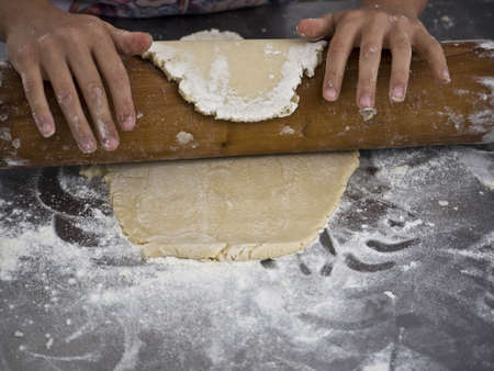 Dough is rolled with a rolling pin
