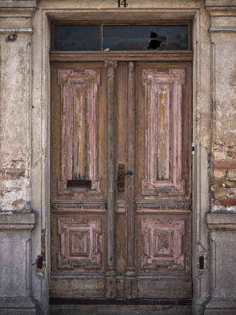 brown wooden door in an old building
