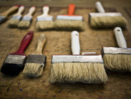 flat brushes: several flat brushes on a wooden table