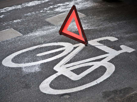 signifier: warning triangle on a cycle path