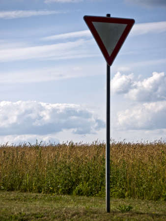 Yield sign on a german road in summer Stock Photo - 12025005