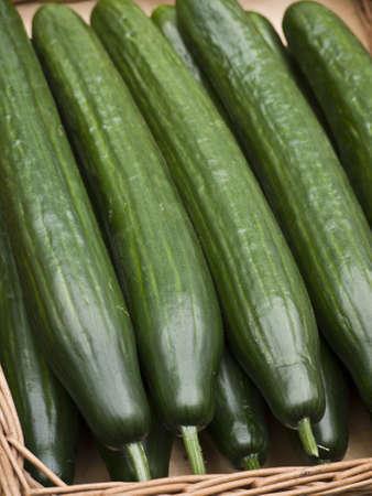 green cucumbers in a basket