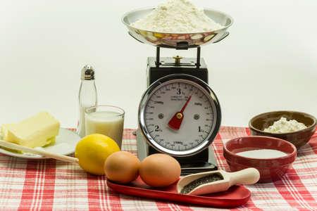 baking powder: Ingredients for a cake - Eggs, lemon, butter, baking powder and flour Stock Photo