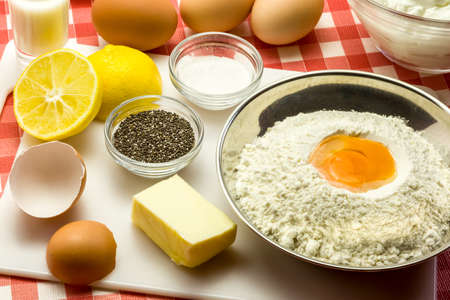 baking powder: Ingredients for a cake with chia seeds - flour, butter, eggs, baking powder, sugar