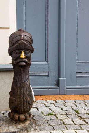 bollards: Zehdenick, Oberhavel, state Brandenburg, Germany - wooden pawn in front of a doorway