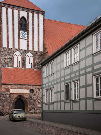 Half-timbered house and church St. Peter-und-Paul in Wusterhausen-Dosse, Ostprignitz-Ruppin, state Brandenburg,germany