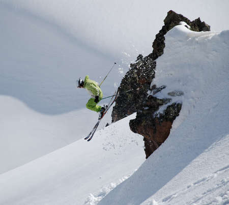 Skier jumping from a cliff  Stock Photo
