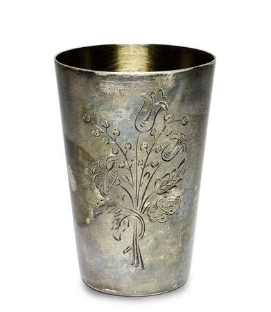 A old silver cup engraved with a picture of a flower Stock Photo