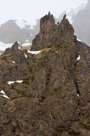Rock in the Caucasus. Mountains in the mist. Stock Photo
