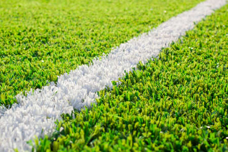 The white line markings on the sports field of artificial green grass Stock Photo