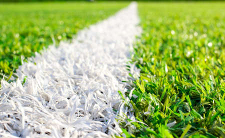 grass area: The white line markings on the sports field of artificial green grass  With a small depth of field