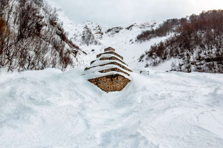 Defenses in the mountains  Stone cones for mitigating the avalanche Stock Photo