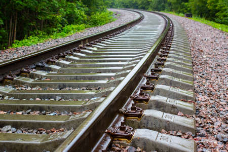 vanishing: Cloudy weather and rain  Railroad track vanishing into the distance  Stock Photo