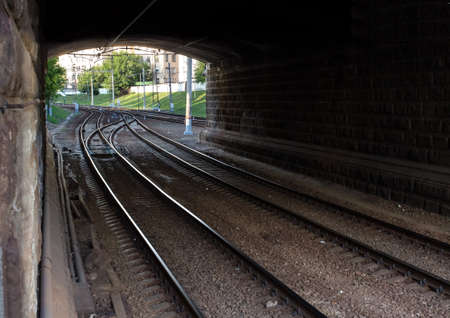 Railway outcome under the stone bridge in the city photo
