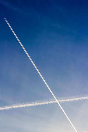 intersecting: Intersecting roads white plane in the blue sky