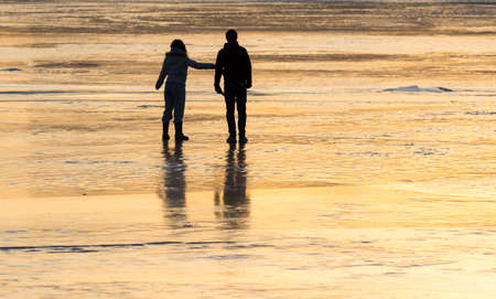 Silhouette couple on the ice