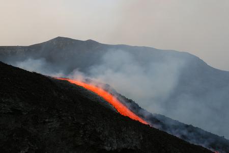etna: lava flow on etna volcano