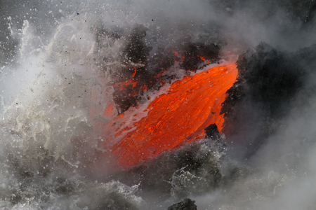 enters: Lava flow enters the sea in Hawaii