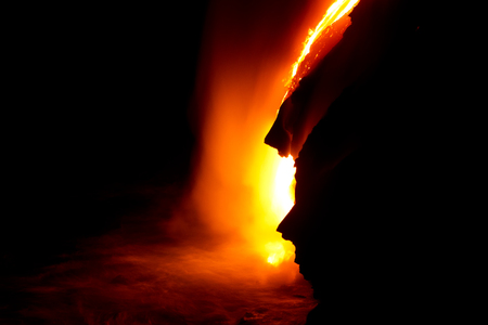 Lava flow at night in Hawaii Фото со стока