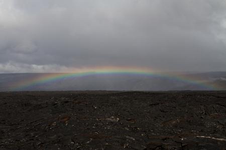lava field: Rainbow over a lava field in Hawaii