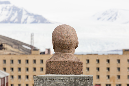 PYRAMIDEN, NORWAY - June 25, 2015: Exterior of the bust of Lenin at the abandoned Russian arctic settlement Pyramiden, Norway