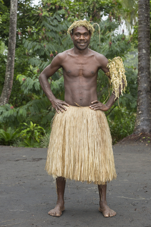 Tanna, Republic of Vanuatu, July 12th, 2014, Portrait of an indigenous man with traditional headdress and skirt Editorial