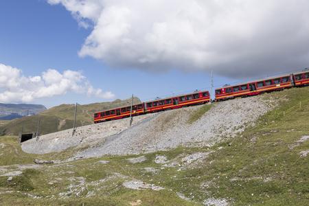 Jungfraujoch, Switzerland - August 22, 2015: Famous cog wheel Train traveling from Grindelwald to Jungfraujoch Editorial