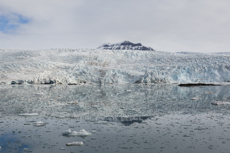 arctic waters: Sea bay with a glacier and icebergs in Svalbard, Spitsbergen, Norway