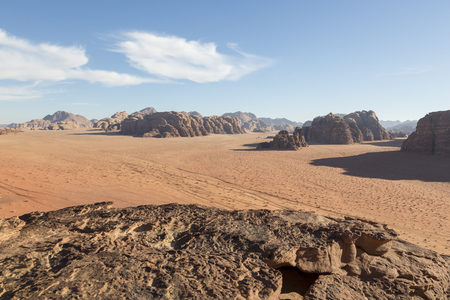Reddish sand and rock landscapes in the desert of Wadi Rum, southern Jordan