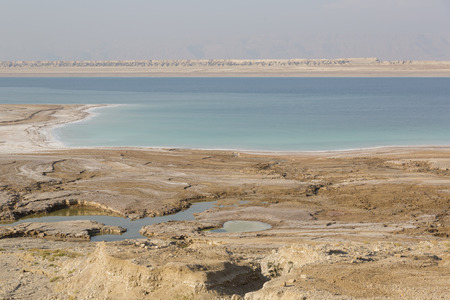 View on a pitfall, sinkholes and conversions of the Dead Sea coast, Jordan