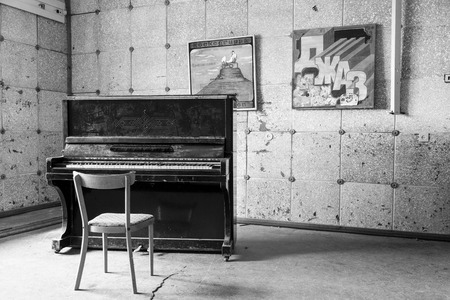 PYRAMIDEN, NORWAY - June 25, 2015: Inside of the ruined building (music room) at the abandoned Russian arctic settlement Pyramiden, Norway. Editorial