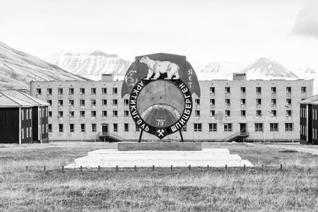 PYRAMIDEN, NORWAY - June 25, 2015: Exterior of the ruined building at the abandoned Russian arctic settlement Pyramiden, Norway Sajtókép