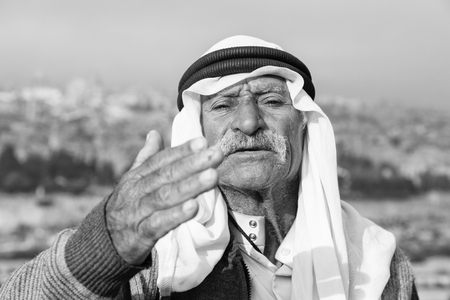 JERUSALEM, ISRAEL - December 2016: Arab man wave to peace against the Temple Mount and lift his arm