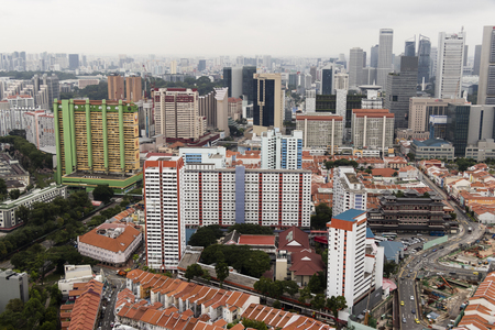 SINGAPORE, December 10 2017: Top view photo shot of some landed property houses and some goverment apartments in the background