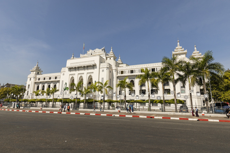Yangon, Myanmar, December 25,2017: The white palace of Yangon City Hall is centrally located and it has been the focal point of several major political demonstrations.