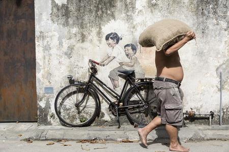 George Town, Penang, Malaysia, December 19 2017:: Little Children on a Bicycle street art mural by Lithuanian artist Ernest Zacharevic in Georgetown, Penang, Malaysia