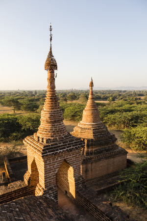 Architectural detail of a pagoda in the foreground and the pagoda field of Bagan in background, Myanmar Stock Photo