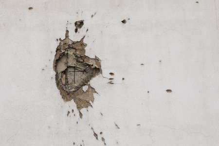 Bullet hole on building wall in Sarajevo