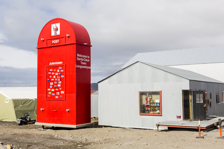 Longyearbyen, Norway, June 26 2016: Giant red mailbox for the Santa Claus in front of the Post Office in Longyearbyen, Spitsbergen, Norway