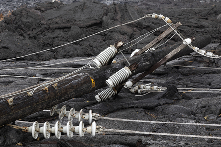 High voltage power line destroyed by a lava flow in Hawaii Фото со стока - 103366092