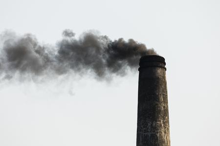 Smoking chimney of a brick factory in Bangladesh