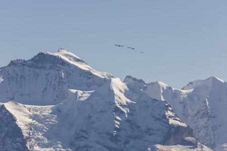 The Swiss Air Force flies a display over the Alps in the Bernese Oberland