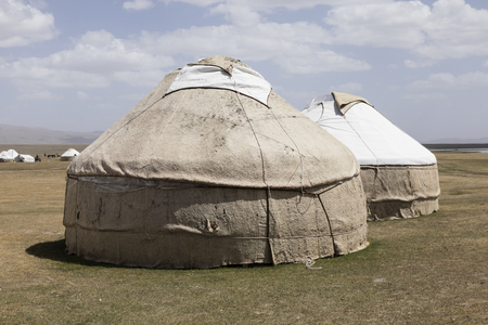 Two old traditional yurts at the Son Kul lake in Kyrgyzstan Stock Photo