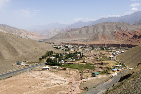 Village with landscape and river around the famous Pamir Highway M41 in Kyrgyzstan in Central Asia Stock Photo