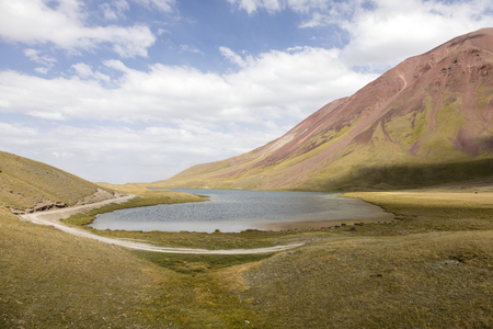 Tulpar Lake in the Pamir Mountains in Kyrgyzstan Stock Photo