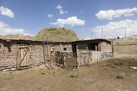 Residential house of border town Sary-Tash in Kyrgyzstan to neighboring Tajikistan on the Pamir Highway in Central Asia